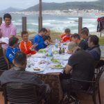 Dirtbike riders having lunch near ocean